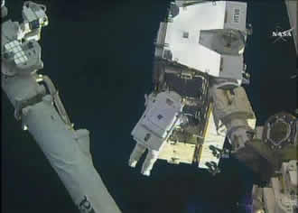 Astronauts upgrade station with latest batteries
