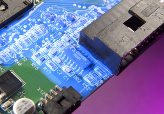 Low viscosity conformal coating cures with light