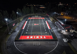 LED flood lights illuminate high school stadium