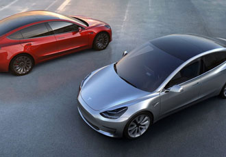 Elon Musk drives early release of Tesla Model 3 electric car