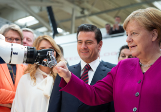 HANNOVER MESSE: Man, machine and fist bumps