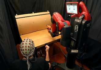 Controlling robots with brainwaves and hand gestures