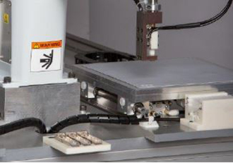 Cost effective automated thermal pad application for die cut TIMs