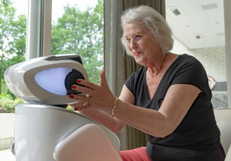 Robot colleague improves elderly care in nursing homes and hospitals