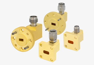 Right angle waveguide to coax adapters operate up to 65GHz