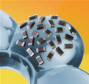 High Frequency, High Q Capacitors For Hi Rel Applications