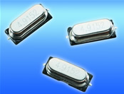 Low cost SMD crystal available in three package heights